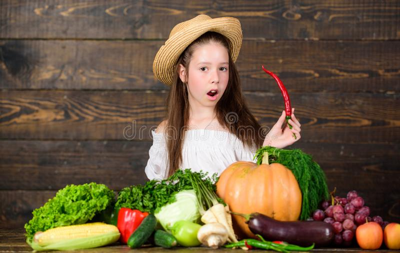Girl kid farm market with fall harvest. Kid farmer with harvest wooden background. Family farm festival concept. Farm. Activities for kids. Traditional farm stock image