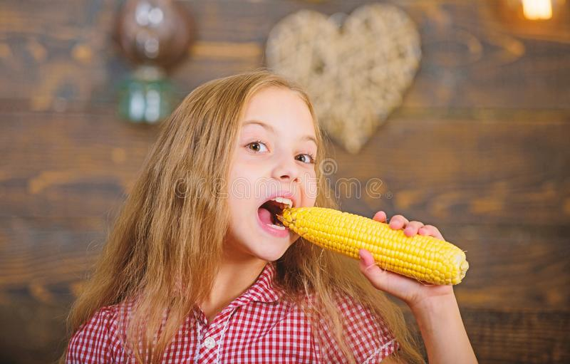 Girl kid at farm market with organic vegetables. Child little girl enjoy farm life. Organic gardening. Grow your own. Organic food. Kid farmer with harvest stock photography