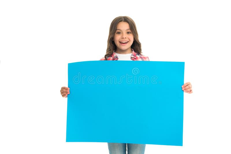 Girl kid hold blank surface copy space. Advertisement concept. Child cute girl happy carries blue paper place for stock photography