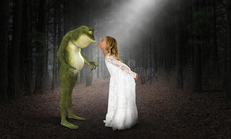 Girl Kiss, Kissing Frog, Princess, Fantasy. A young girl plays with her imagination to kiss a frog in a forest or woods. Kissing an animal from nature creates a stock image