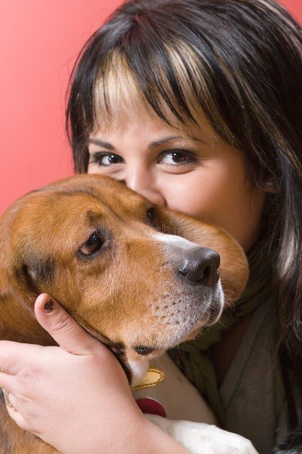 Girl Kisses Her Dog stock photography