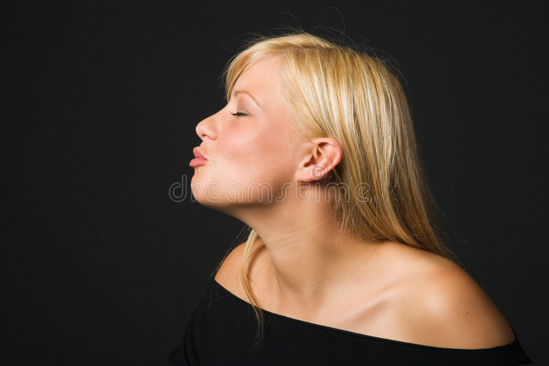 Girl kissing stock photos
