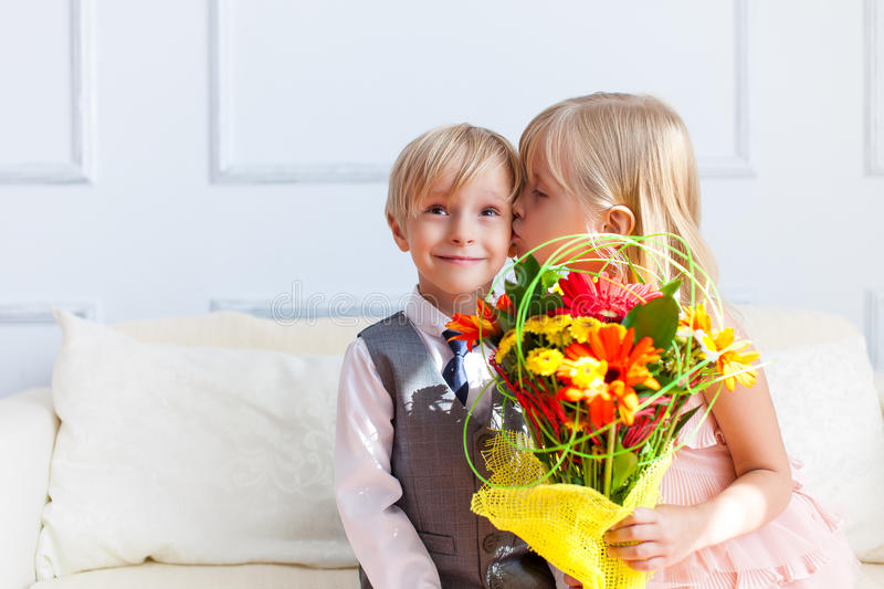 Girl is kissing boy. stock images