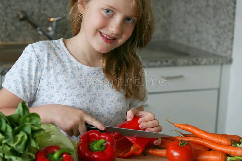 Girl at the kitchen stock photo