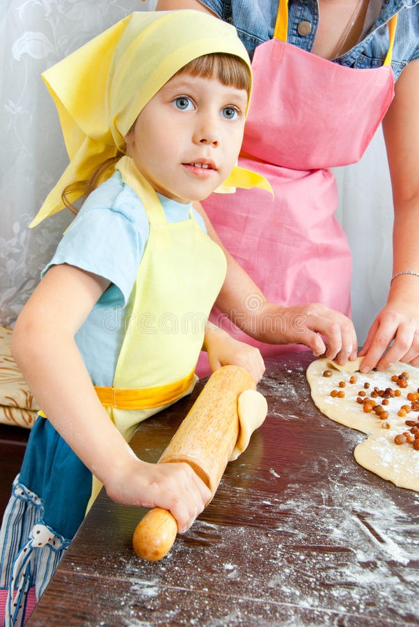 The girl in the kitchen royalty free stock images