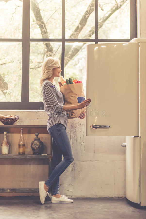 Girl in kitchen stock photography