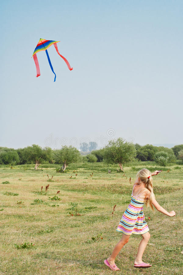 Download The girl with a kite stock photo. Image of happiness - 15427544