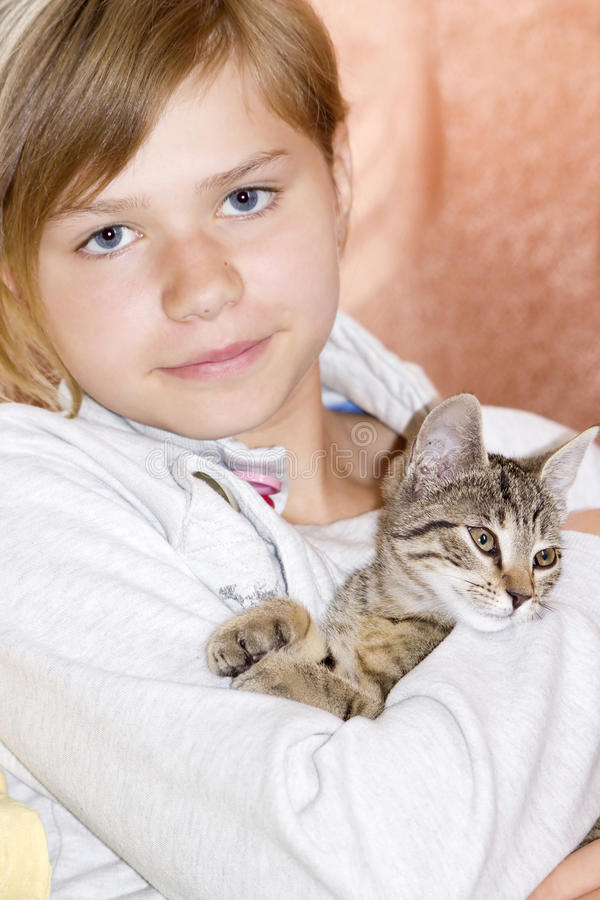 Girl with kitten royalty free stock photos