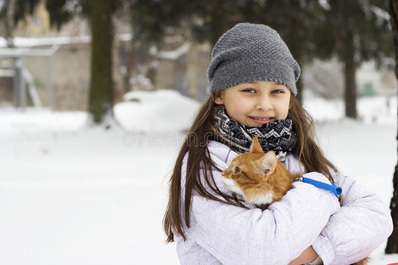 Girl and kitten stock photo