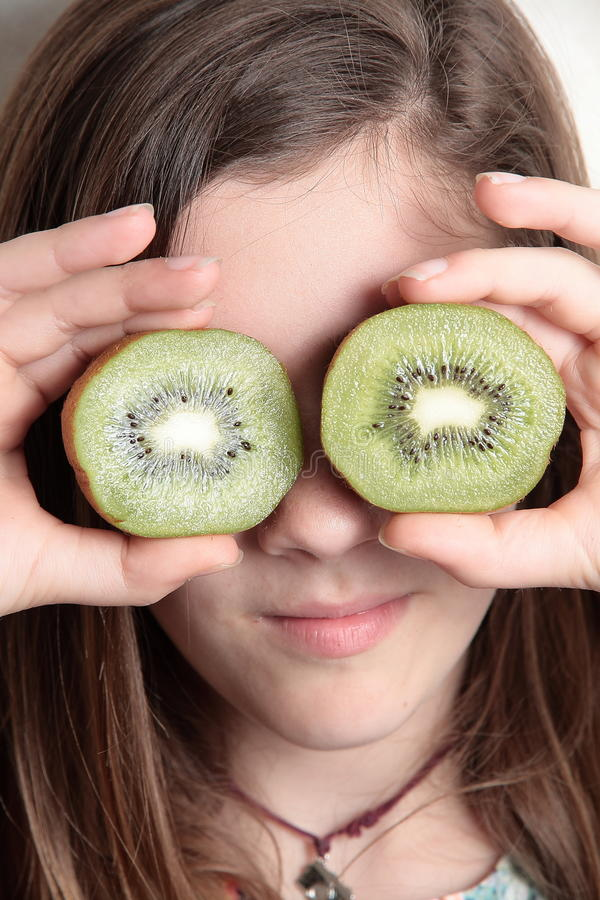 Girl with kiwi eyes stock photos