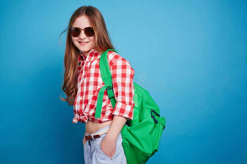Girl with knapsack. Little girl with knapsack looking at the camera stock photo