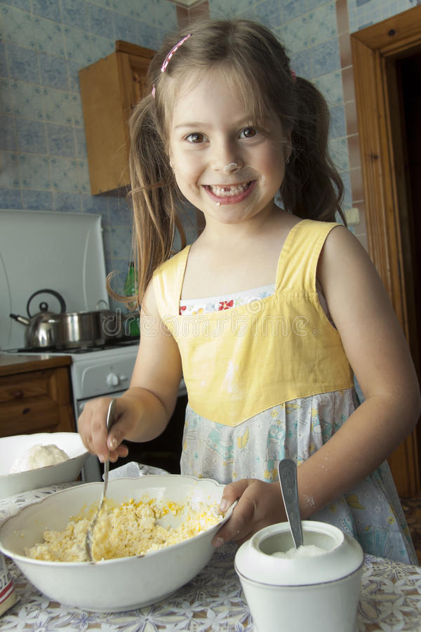 Girl kneads dough stock images