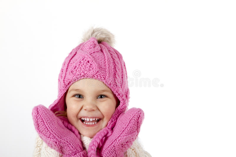 Girl in a knitted hat and mittens. stock images