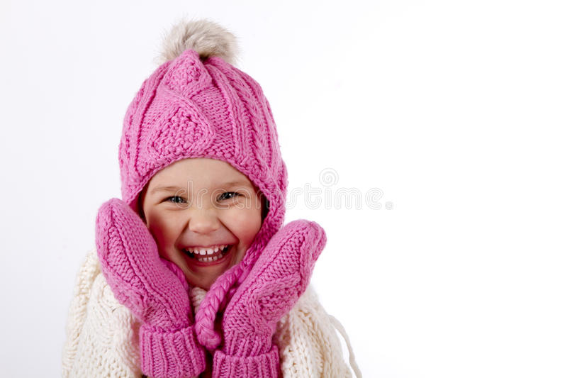 Girl in a knitted hat and mittens stock photography