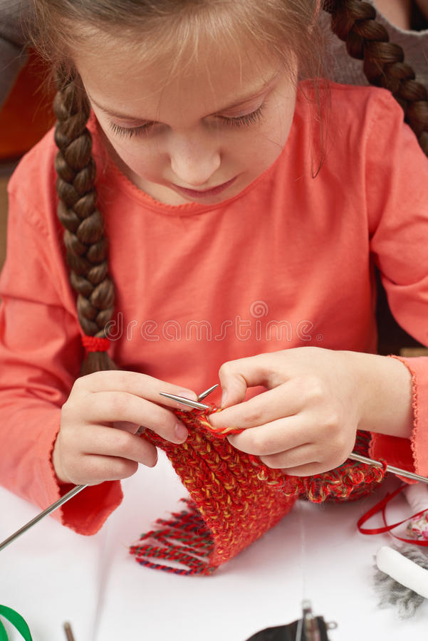 Girl knitting a scarf, sewing accessories, seamstress workplace, many object for needlework, handmade and handicraft stock images