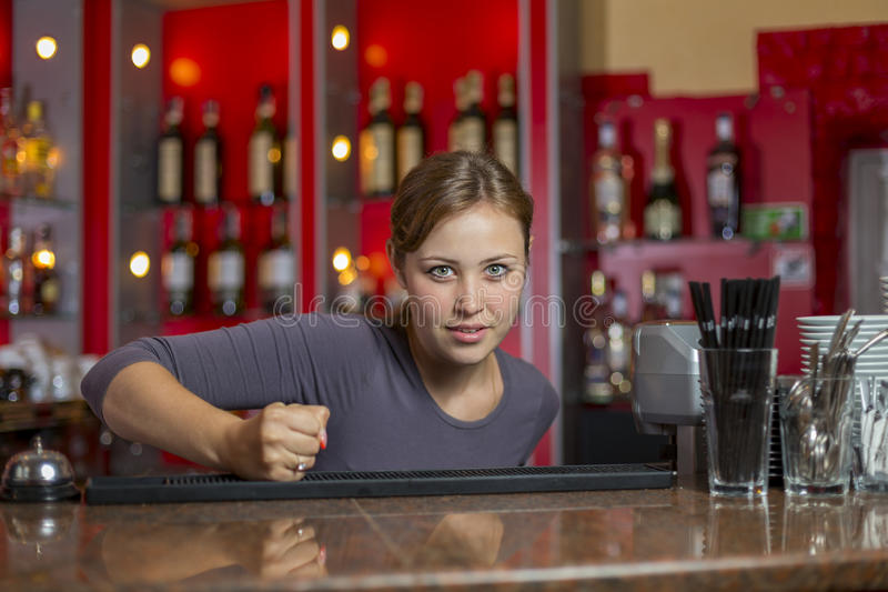 Girl knocks on the table. With his fist stock photography