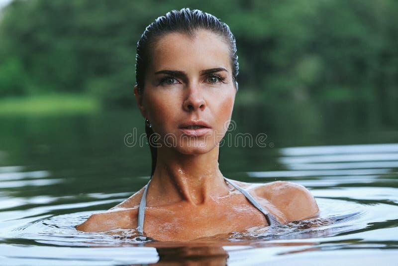 Girl in the lake stock image