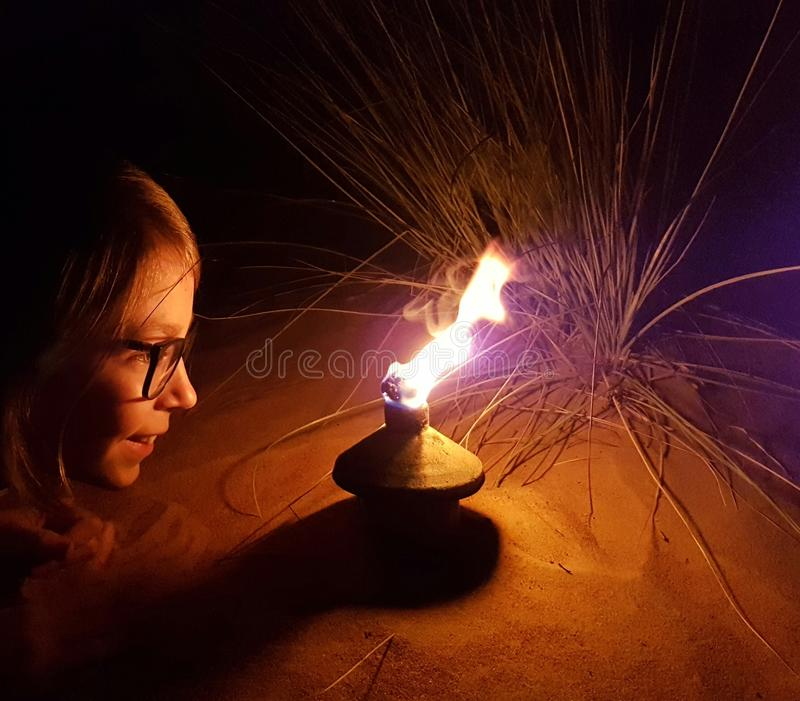 Girl with lamp in desert royalty free stock image
