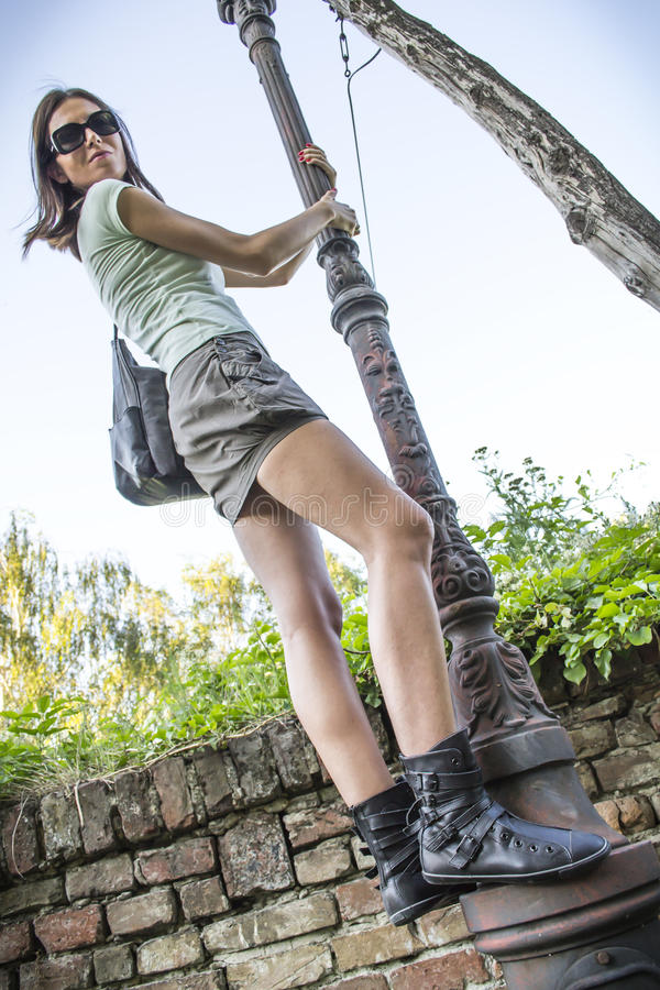 Download Girl at the lamppost stock image. Image of attractive - 26403265