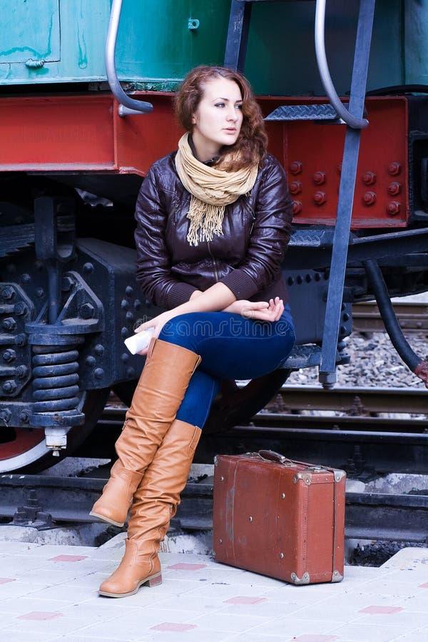 Girl for landing on the platform stock images
