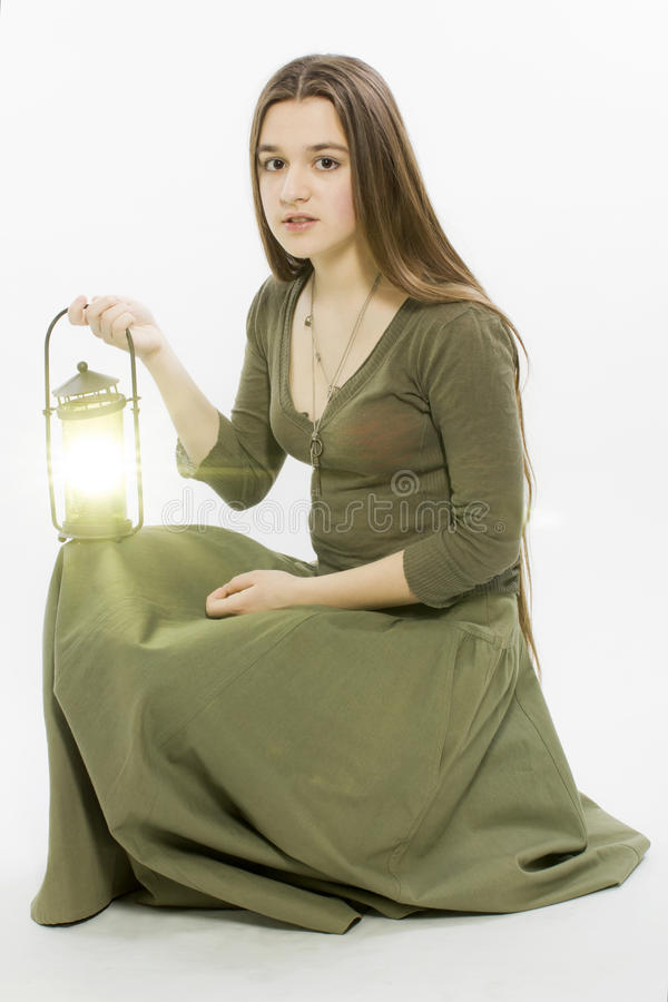 The girl with a lantern stock photography