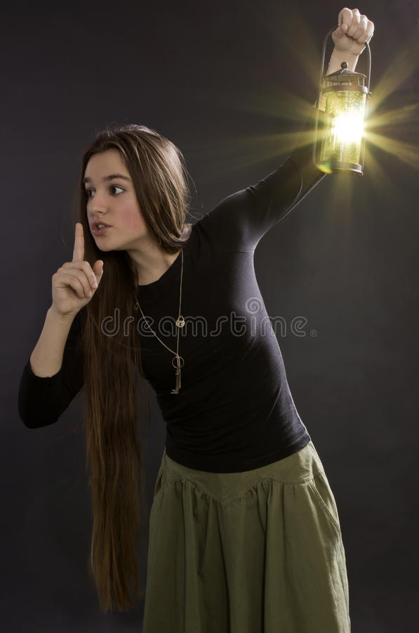 The girl with a lantern stock image
