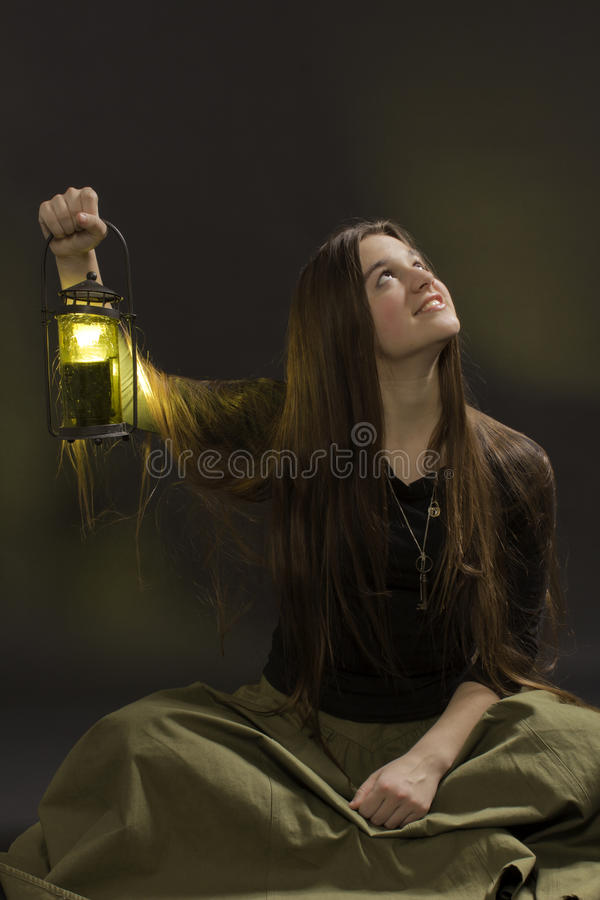 The girl with a lantern royalty free stock image
