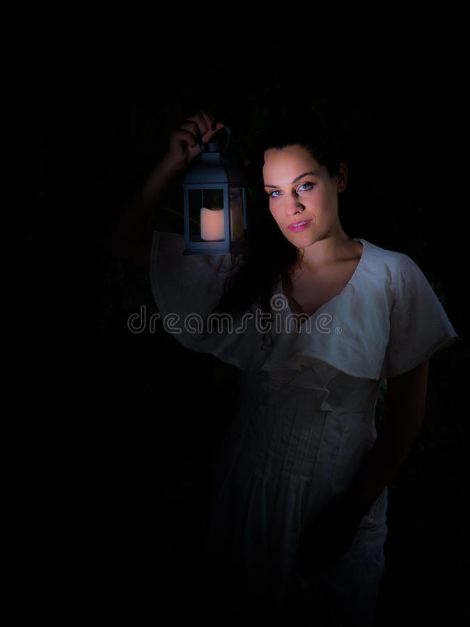 Girl with lantern royalty free stock photography