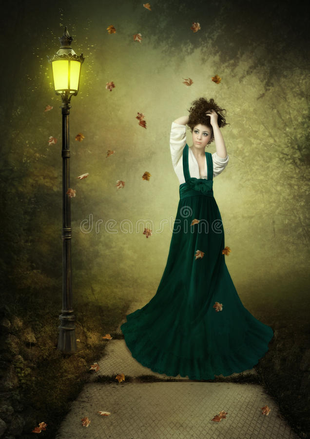 Girl and lantern royalty free stock image