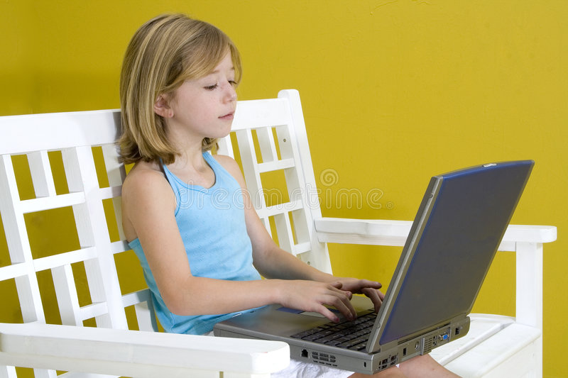 Girl on Laptop royalty free stock photos