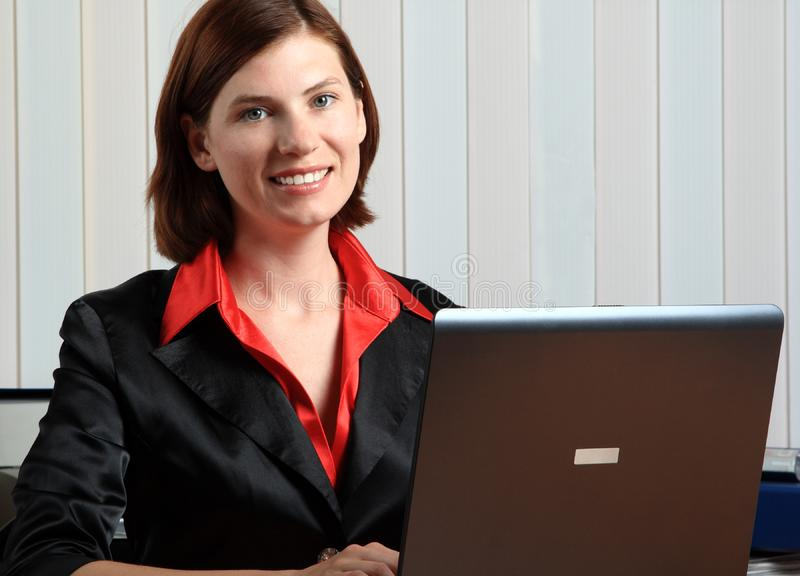 The girl with the laptop stock photo