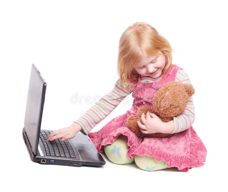 Girl with laptop and toy isolated on white royalty free stock image
