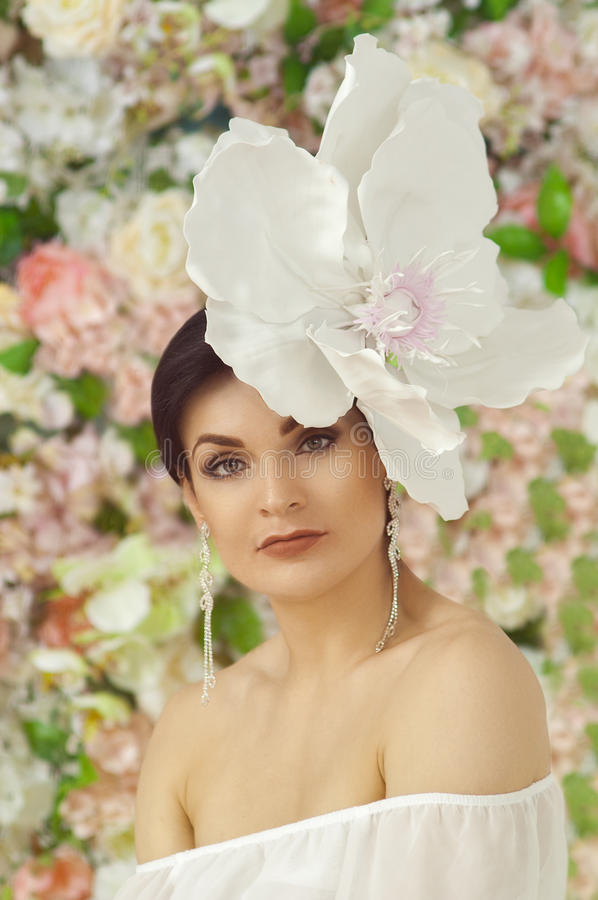 Girl with a large flower on the head royalty free stock image
