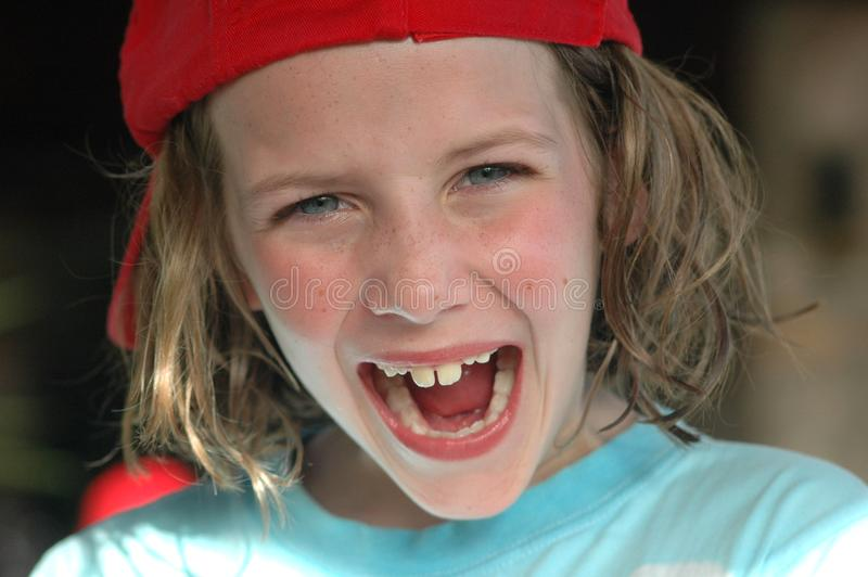 Girl laughing. Nikon D70, close-up portrait of child royalty free stock photography