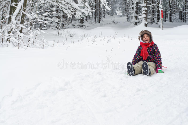 Girl Laughing in Snow stock photo