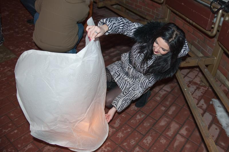 Girl launches sky lantern, for the day of all lovers, valentines day. fanarik liveings.  stock image