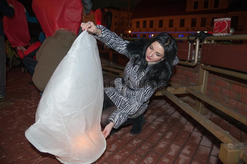 Girl launches sky lantern, for the day of all lovers, valentines day. fanarik liveings.  stock photography
