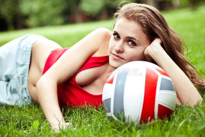 Download Girl Lay On Grass With Volleyball Ball Royalty Free Stock Photography - Image: 10473347