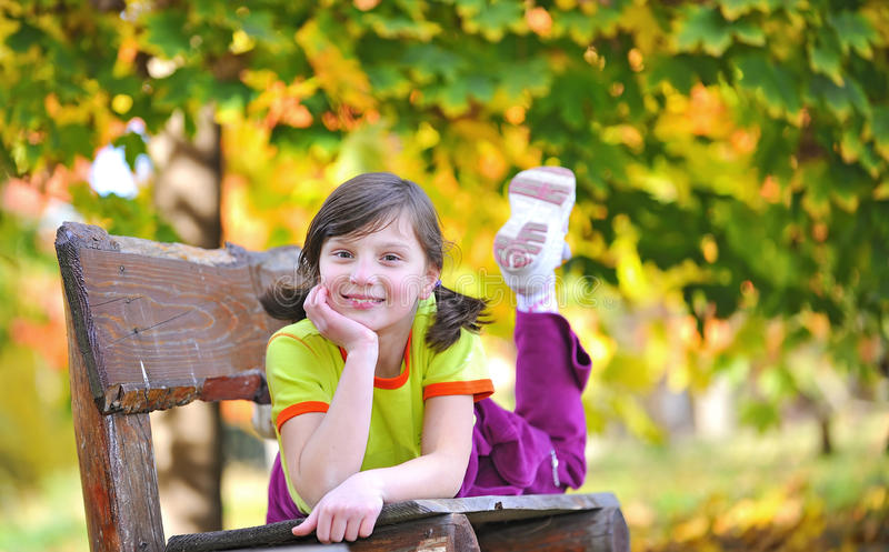 Download Girl Laying Down On A Bench Stock Photo - Image: 23686614