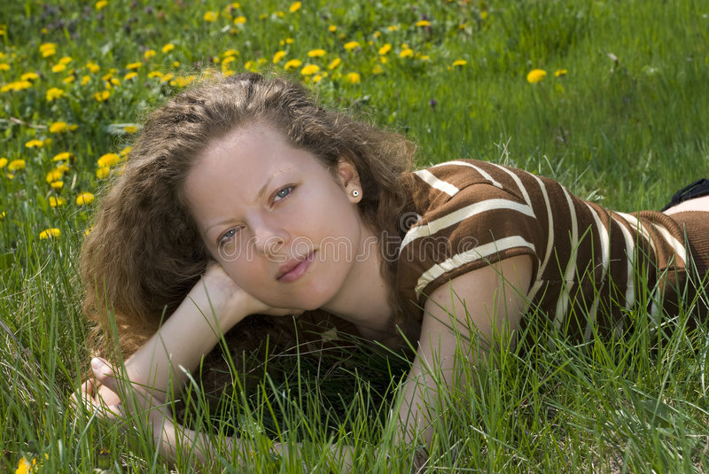 Download Girl laying in the grass stock photo. Image of grassland - 9093836