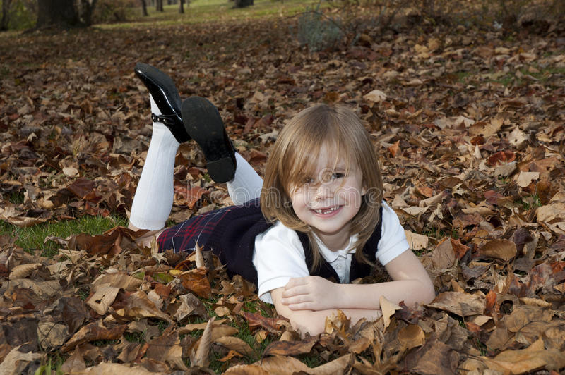 Download Girl laying in leaves stock photo. Image of girl, teeth - 24707010