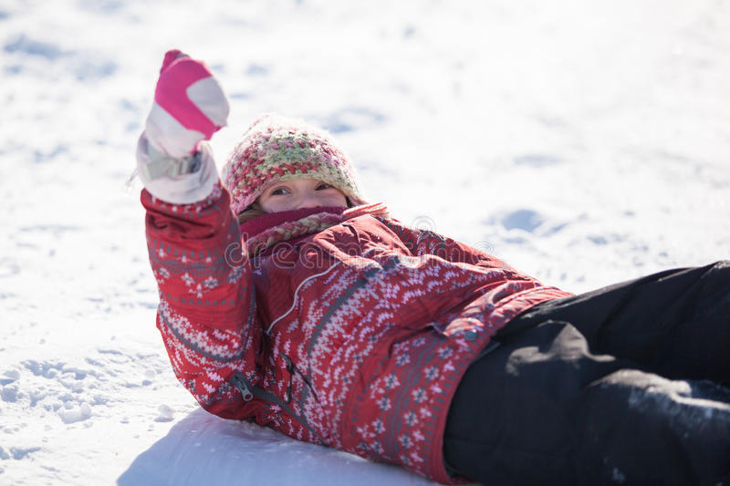 Girl laying in the snow stock photography