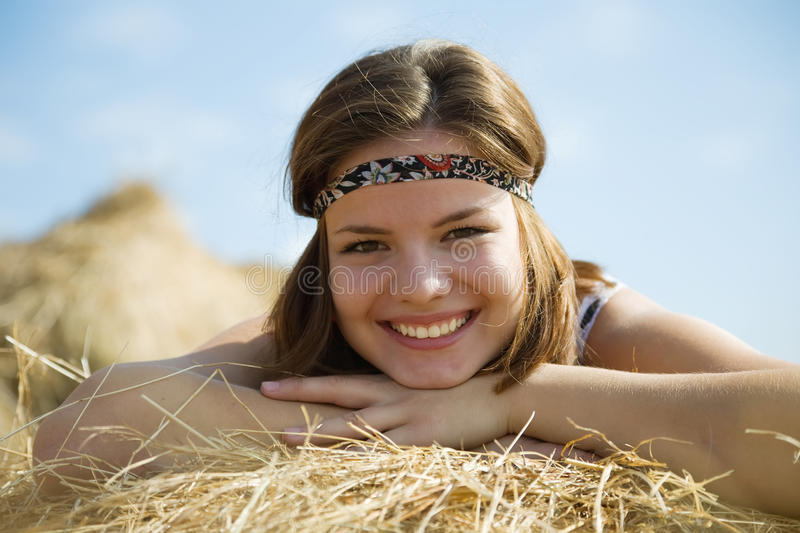 Download Girl laying on straw bail stock photo. Image of girl - 16088178