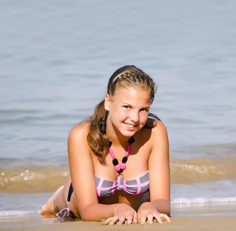 Girl lays in at sea coast