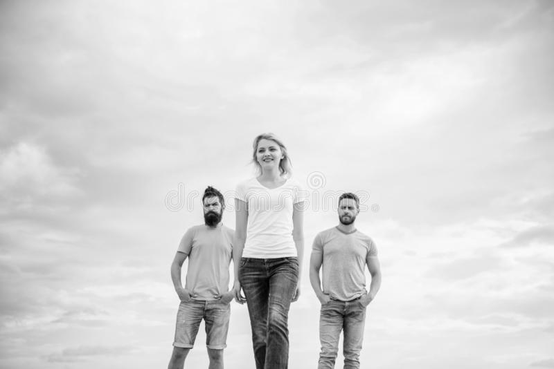Girl leader qualities possess naturally. Influential women leader. Leadership concept. Woman in front of men feel. Confident. Moving forward support male team stock photo