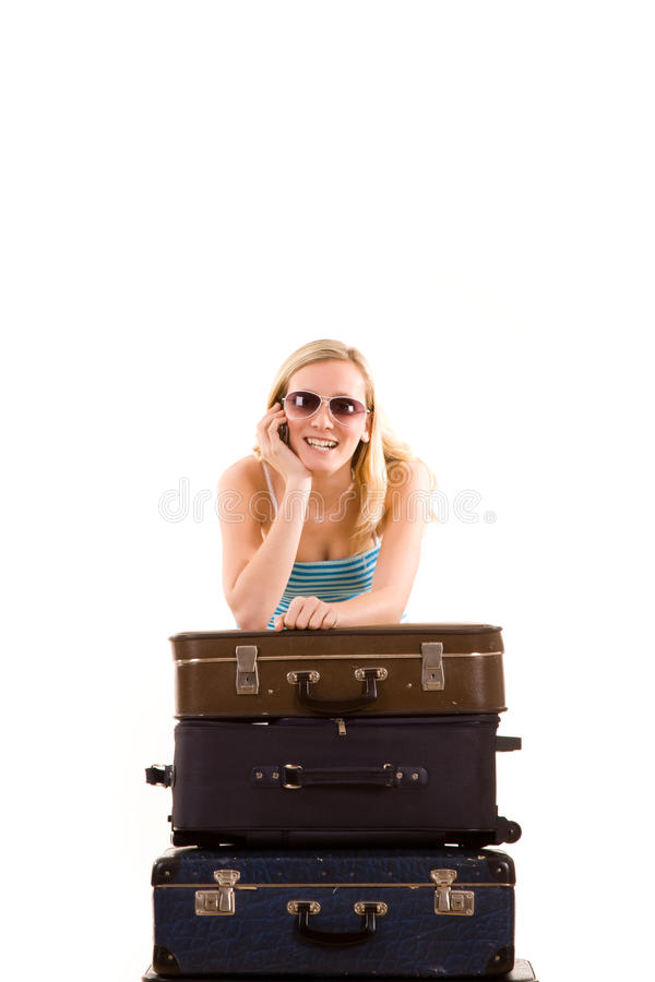 Girl Leaning On Suitcases Stock Images