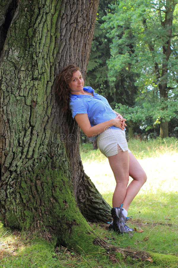 Girl Leaning On A Tree Royalty Free Stock Photography