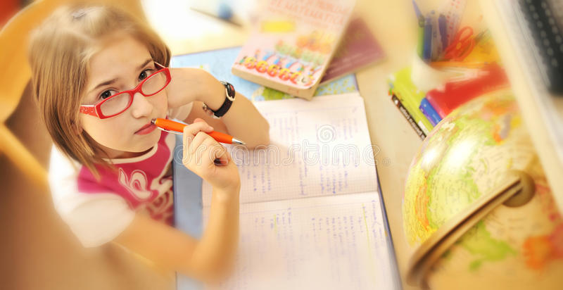 Girl learning at home stock image