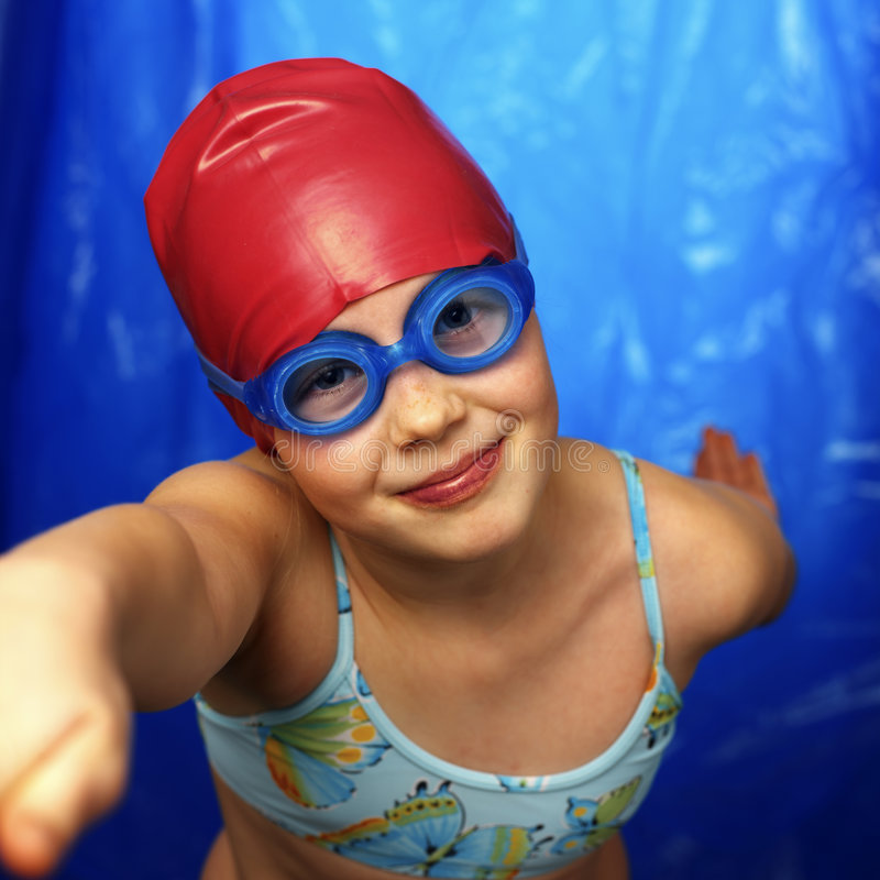 Girl learning how to swim. Girl in swmming pool royalty free stock photo
