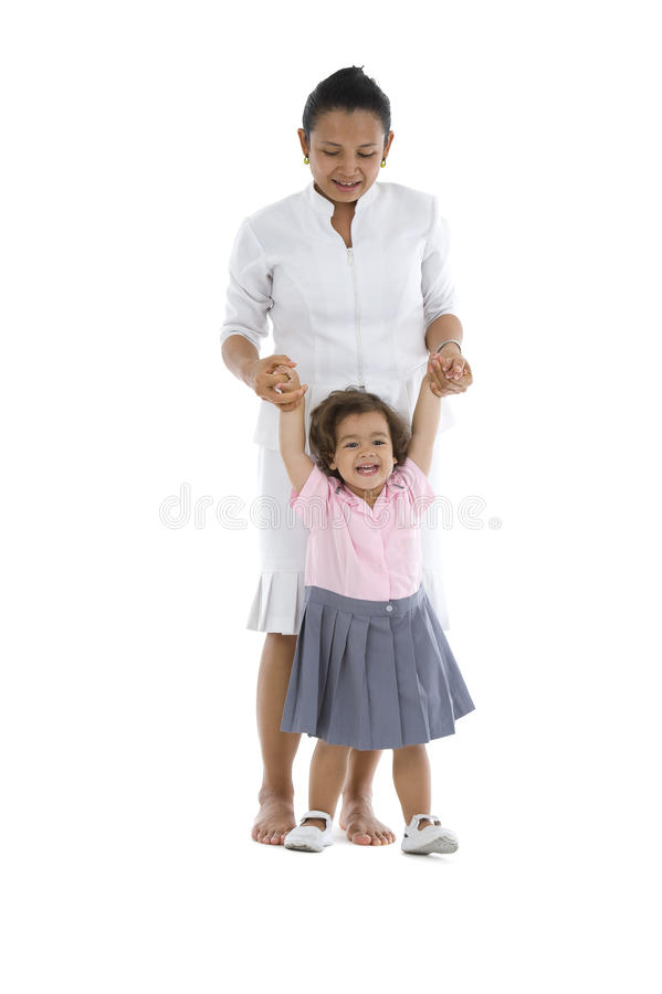 Download Girl learning how to walk stock photo. Image of standing - 16448492